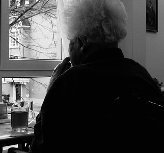 photo - elderly woman at window