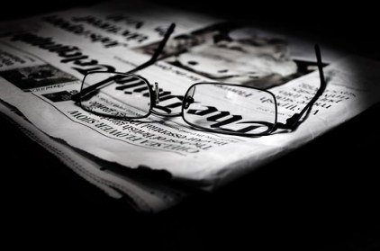 newspaper front page & glasses